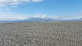 Sandy beach. Panorama view of a beach with mountain in the background Stock Photos