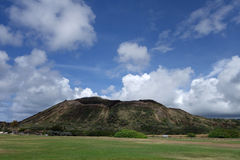 Sandy Beach Park grass field and Koko Head Crater Stock Photography