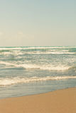 Sandy beach in pastel colors Stock Images