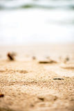 Sandy Beach, Pebbles and Sea on the Background Stock Images