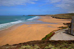 Sandy beach Perranporth Cornwall England UK rich colours. Perranporth beach North Cornwall England UK in rich colourful HDR royalty free stock images