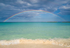Sandy beach and rainbow Royalty Free Stock Photography