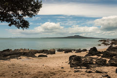 Sandy beach with Rangitoto Island, New Zealand Royalty Free Stock Images