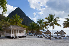 Sandy beach resort next to piton mountain Royalty Free Stock Photography