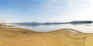 Sandy Beach on the River Amur. Khabarovsk region of the Russian Far East. Beautiful Bank of the Amur River snowy mountains and. Sandy beaches royalty free stock photography