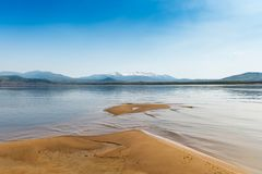 Sandy Beach on the River Amur. Khabarovsk region of the Russian Far East. Beautiful Bank of the Amur River snowy mountains and. Sandy beaches royalty free stock images