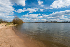 Sandy beach at a river on a beautiful day Royalty Free Stock Photo