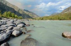 Sandy beach on the river Katun, Altai Mountains Siberia, Russia Royalty Free Stock Image