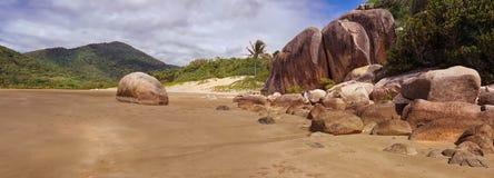 Sandy beach with rocks Royalty Free Stock Photos