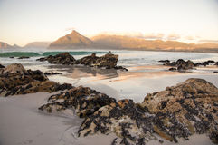 Sandy beach with rocks. On warm day, near Cape Town, South Africa Stock Image