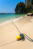 Sandy beach, rope and boat Royalty Free Stock Images