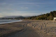 Sandy beach. Rugged wheels of the car Stock Photo