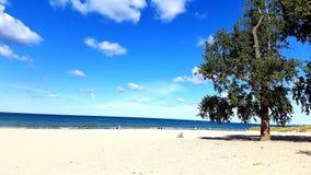 Sandy beach. Sand beach lake Michigan water sky Royalty Free Stock Photo