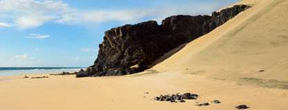 Fuerteventura beach panorama. Fuerteventura Costa Calma long stretches of sandy beaches. Panorama photography made of 4 different shots for a large landscape Stock Image