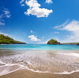 Sandy beach of the sea and green hills. Indonesia.Landscape in a sunny day Stock Photo