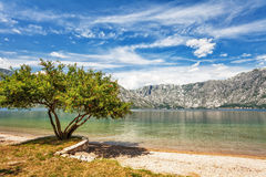Sandy beach with sea and mountain Royalty Free Stock Photos