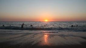 Sandy beach sea ocean wave sunset horizon stock footage
