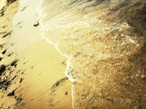 Sandy beach and sea wave Stock Photography