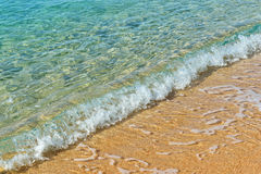 Sandy beach and sea waves Stock Photos