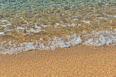 Sandy beach and sea waves Royalty Free Stock Image
