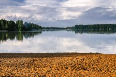 Sandy beach on the shore of lake Biserovo, Moscow region, Russia. Royalty Free Stock Photo