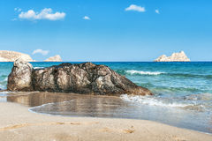 Sandy beach with stones on a foreground on Crete island, Greece Royalty Free Stock Photography