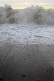 Sandy beach and stormy sea against Stock Photo