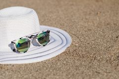 Beach with summer accessories. Sandy beach with summer accessories stock photo