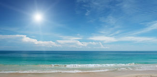 Sandy beach and sun Royalty Free Stock Images