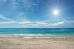 Sandy beach and sun Stock Image
