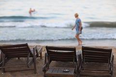 Sandy beach sunbeds umbrellas Stock Images