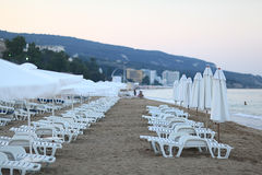 Sandy beach sunbeds umbrellas Stock Image