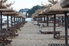 Sandy beach sunbeds umbrellas Royalty Free Stock Image