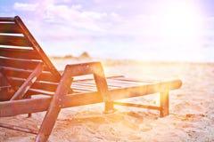 Sandy beach sunbeds umbrellas Royalty Free Stock Photo