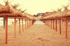 Sandy beach sunbeds umbrellas Stock Photography