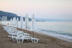 Sandy beach sunbeds umbrellas sea Royalty Free Stock Photography