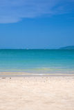 Sandy beach on sunny day Stock Images