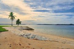 Sandy beach. Sunset on sandy beach coast and stone wave breaker Stock Images