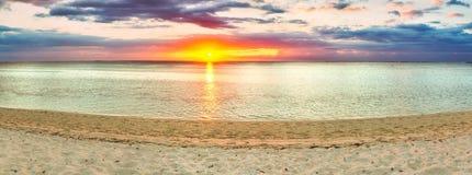 Sandy beach at sunset. Panorama Stock Photos