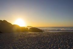 Sandy beach at sunset Stock Image