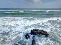 Sea surf sky sand sand beach. Sandy beach surf of the sea wave and the blue sky and a few clouds. Surf of the sea to a sandy beach Royalty Free Stock Photo