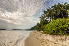 Sandy beach of a tropical island. Koh Chang. Royalty Free Stock Photos
