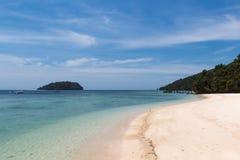 Sandy beach on a tropical island. Stock Image