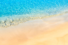 Sandy beach and turquoise crystal clear water Stock Photos