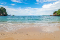Sandy beach and turquoise sea in a tropical place Stock Photos
