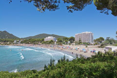 Sandy beach and turquoise water. CANYAMEL, MALLORCA, BALEARIC ISLANDS, SPAIN - JULY 19, 2016: Sandy beach and turquoise water with foamy waves on July 19, 2016 Stock Photography