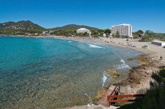 Sandy beach and turquoise water. CANYAMEL, MALLORCA, BALEARIC ISLANDS, SPAIN - JULY 19, 2016: Sandy beach and turquoise water with foamy waves on July 19, 2016 Royalty Free Stock Photos
