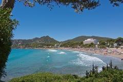 Sandy beach and turquoise water. CANYAMEL, MALLORCA, BALEARIC ISLANDS, SPAIN - JULY 19, 2016: Sandy beach and turquoise water with foamy waves on July 19, 2016 Stock Photo