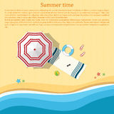Sandy beach with an umbrella and beach accessories. Top view. Su Royalty Free Stock Photography