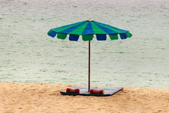 Sandy beach with umbrella, mattress and pillow. Beautiful sandy beach with umbrella, mattress and pillow Royalty Free Stock Photography